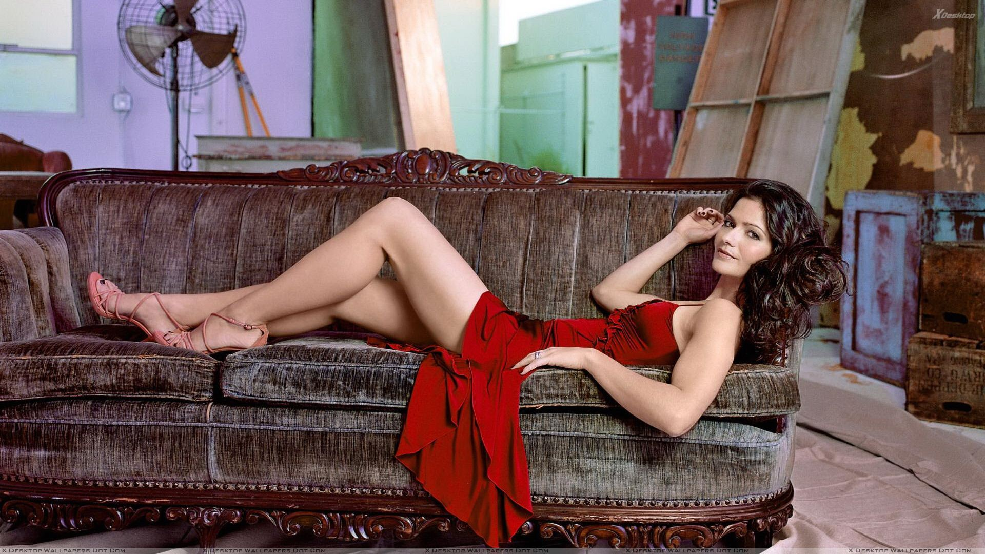 Jill Hennessy In Red Dress Laying Pose Photoshoot