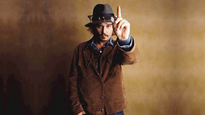 Johnny Depp Showing Goggles In Hand Photoshoot