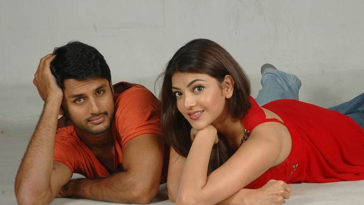 Kajal Aggarwal And Nitin Laying Pose In Red Dress – Aatadista