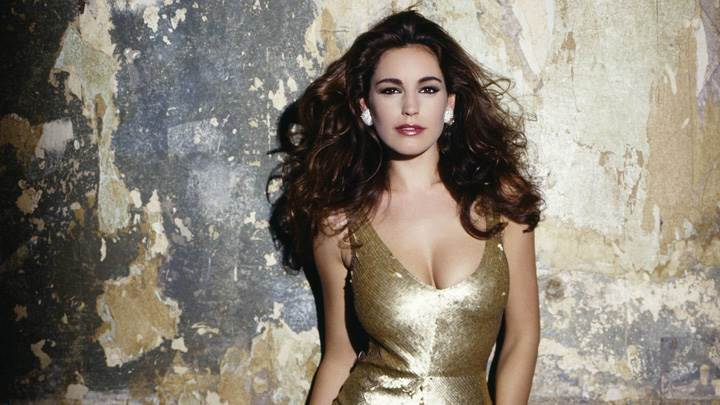 Kelly Brook Looking At Camera In Golden Dress Front Pose
