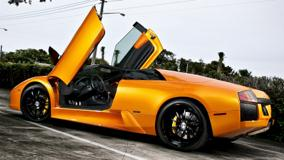 Lamborghini Murcielago In Orange Doors Open Side Pose