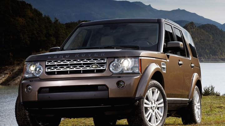Land Rover Discovery 2010 In Brown Near Hills
