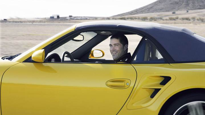 Matthew Fox Smiling In Yellow Car Photoshoot