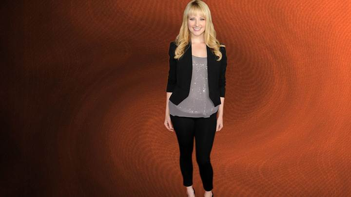 Melissa Rauch Smiling In Black Dress Modeling Pose