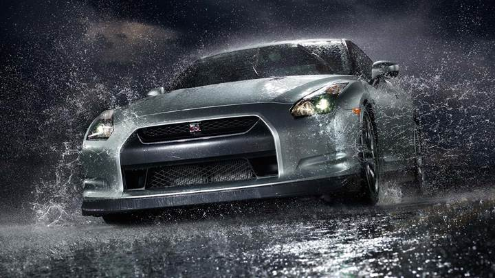Nissan Gtr Front Pose After Rain In Black Night