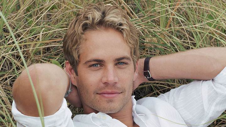 Paul Walker Laying On Grass In White Shirt Photoshoot