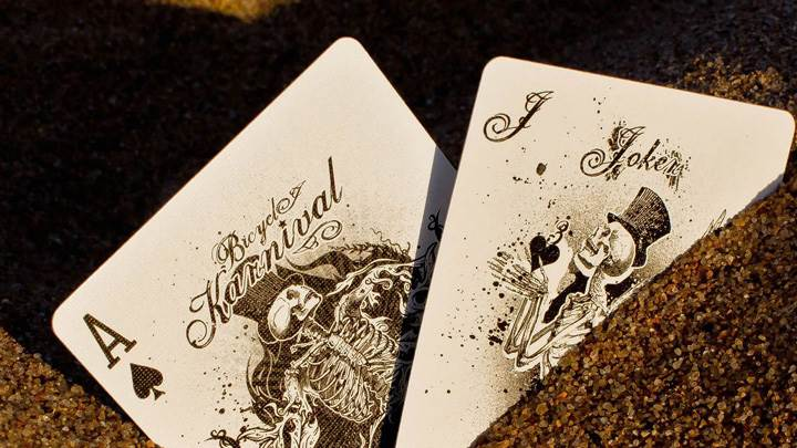 Playing Cards Buried In The Sand