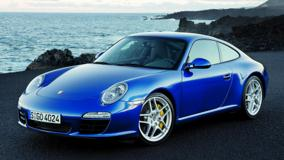 Porsche 911 Carrera S In Blue Near Sea Side