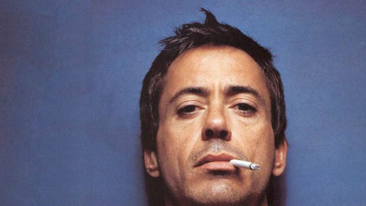 Robert Downey Jr. Doing Smoking Face Closeup N Blue Background