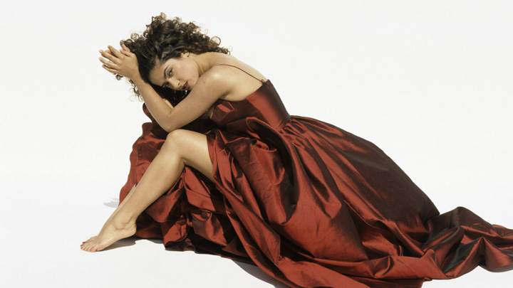Salma Hayek Sitting Pose In Long Dress N White Background