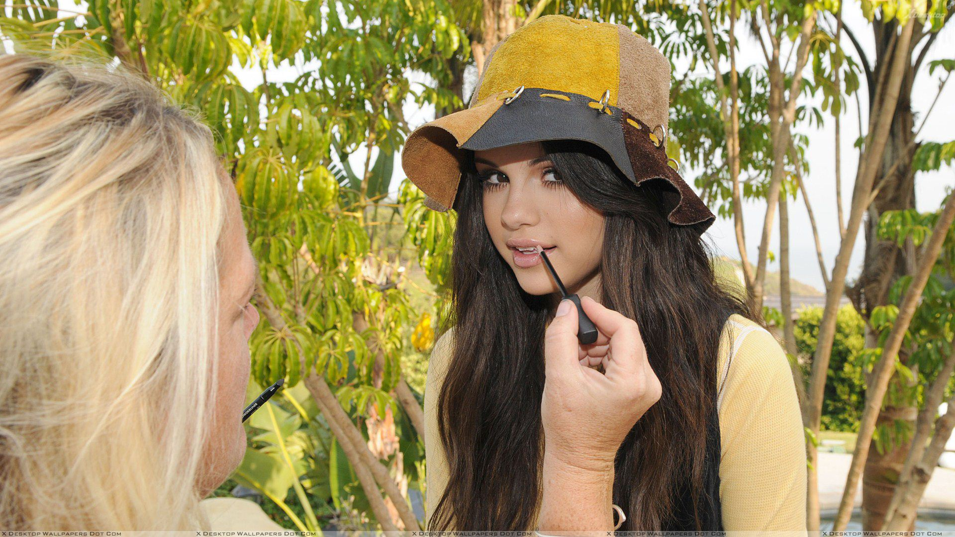 Selena Gomez Doing Makeup N Wearing Yellow Hat