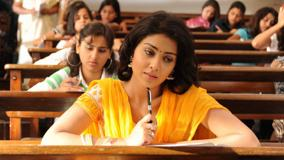 Shriya Saran In Yellow Dress Thinking Photoshoot In Exam