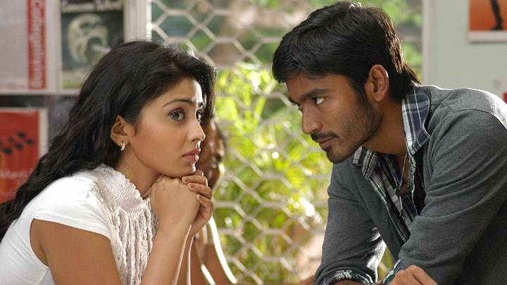 Shriya Saran N Dhanush Sitting Pose In Kutty Movie