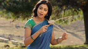 Shriya Saran Open Mouth N Instrument In Hand In Kutty Movie