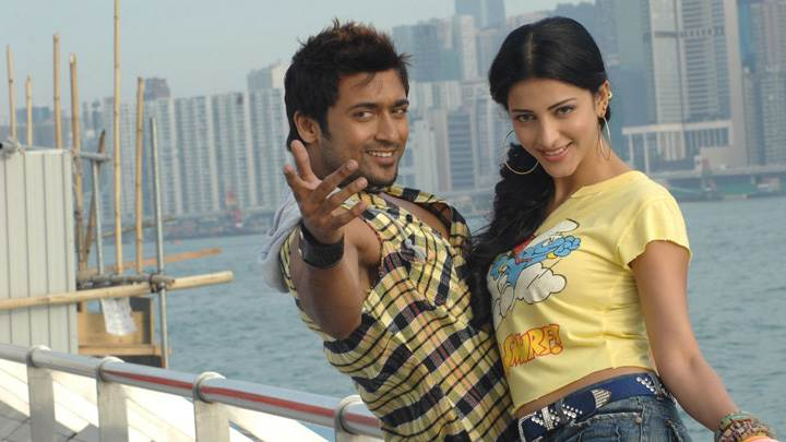 Shruti Haasan And Surya Looking At Camera In Yellow Dress – 7aum Arivu Movie
