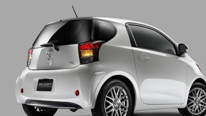 Side Back Pose Of 2011 Scion iQ In White