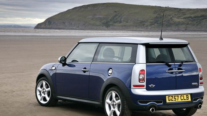 Side Back Pose Of Mini Cooper S In Blue Near Mountains N Sea