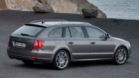 Side Back Pose Of Skoda Superb Combi Near Sea