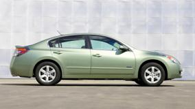 Side Pose Of 2008 Nissan Altima Hybrid In Green