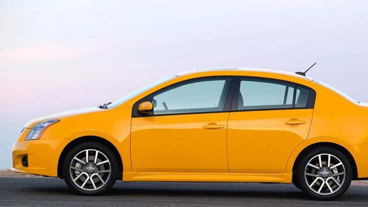 Side Pose Of 2008 Nissan Sentra SE-R In Yellow