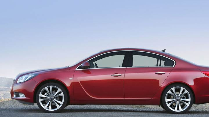 Side Pose Of 2009 Opel Insignia In Red