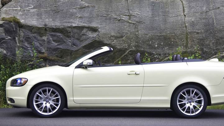 Side Pose Of 2009 Volvo C70 In White Near Mountains