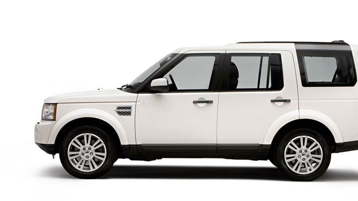 Side Pose Of 2010 Land Rover Discovery In White