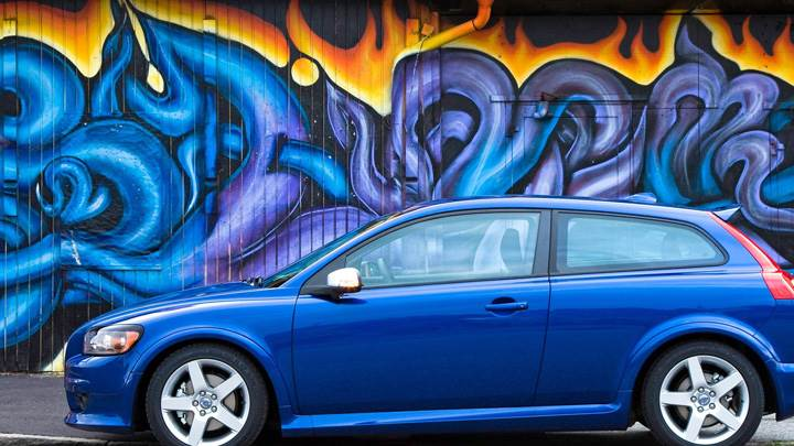 Side Pose Of 2010 Volvo C30 In Blue N Painted Background
