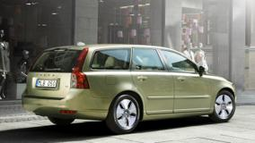 Side Pose Of 2010 Volvo V50 In Green