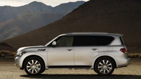 Side Pose Of 2011 Infiniti QX56 In White Near Moutains