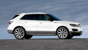 Side Pose Of 2011 Saab 9-4X In White