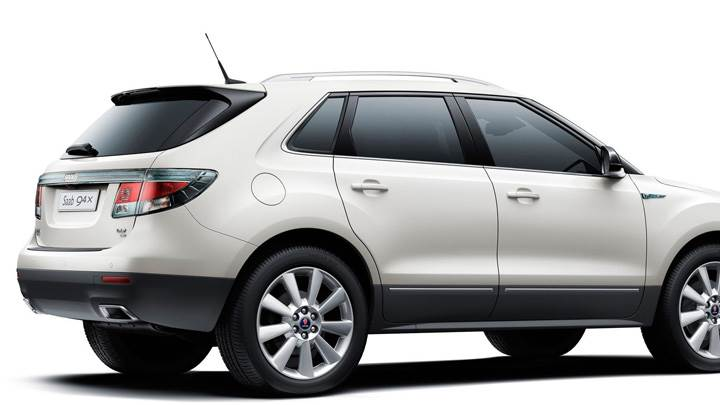 Side Pose Of 2011 Saab 9-4X On White Background