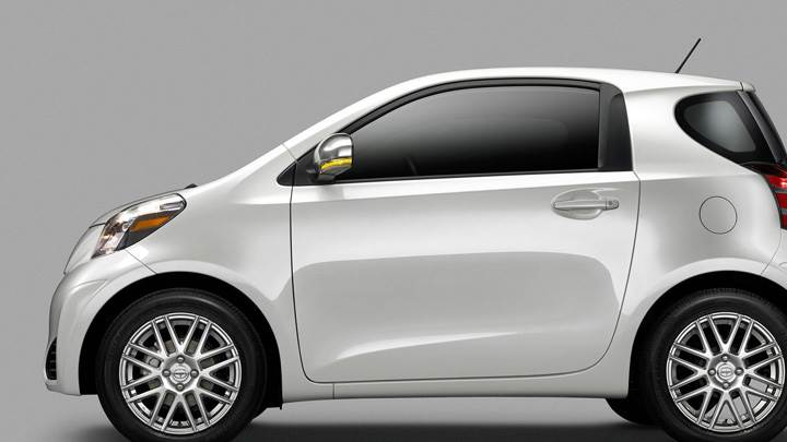 Side Pose Of 2011 Scion iQ In White