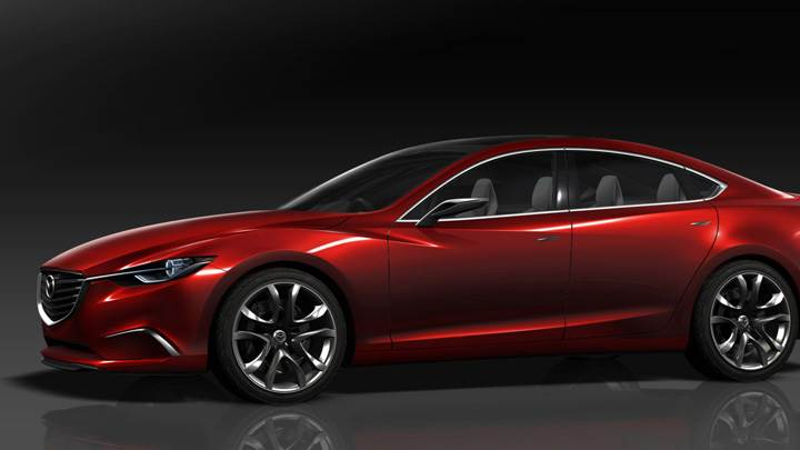 Side Pose Of Mazda Takeri Concept Saloon In Red