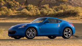 Side Pose Of Nissan 370Z In Blue Standing On Road