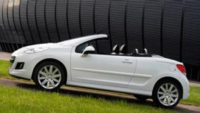 Side Pose Of Peugeot 207 CC Restyled In White