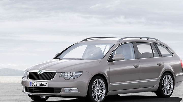 Skoda Superb Combi In Grey Near Mountains N Sea