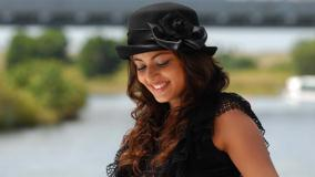 Sneha Ullal Smiling In Black Dress Looking Down Photoshoot