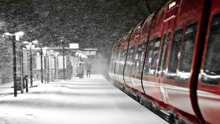Snowfall On Railway Station N Red Train Closeup