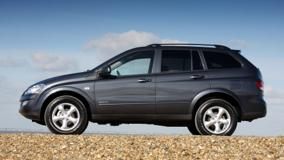 SsangYong Kyron 2008 Side Pose In Black Near Sea