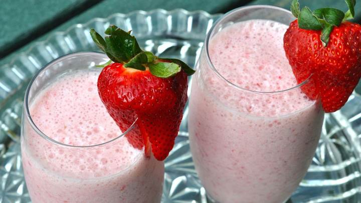 Strawberry On Milk Shake Glasses
