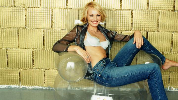 Susann Atwell Smiling Sitting Pose In Blue Jeans