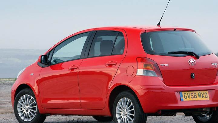 Toyota Yaris Near Sea In Red Back Side Pose