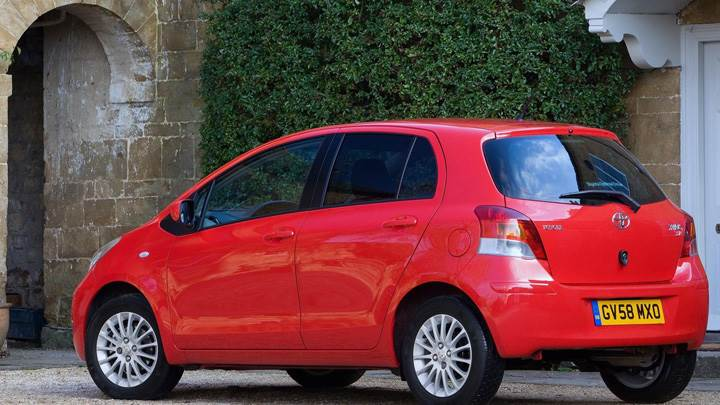 Toyota Yaris Side Back Pose In Red