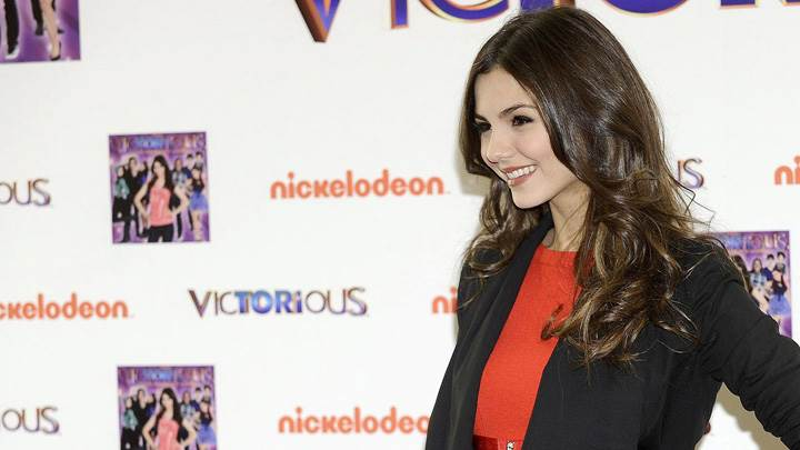 Victoria Justice Smiling In Black Jacket Side Pose Photoshoot
