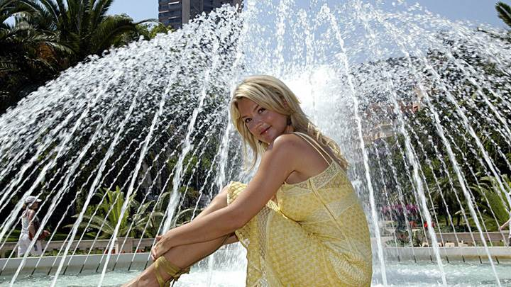 Virginie Efira Sitting In Yellow Dress At Fountains Side