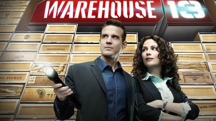 Warehouse 13 – Eddie Mcclintock Torch In Hand And Joanne Kelly