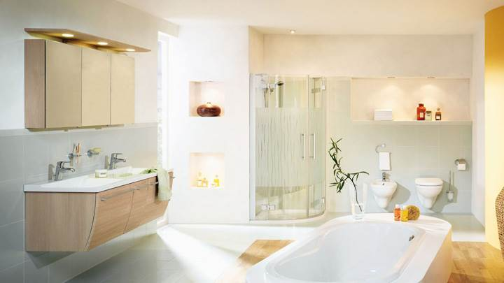 White Bathtub And White Interior In Bathroom
