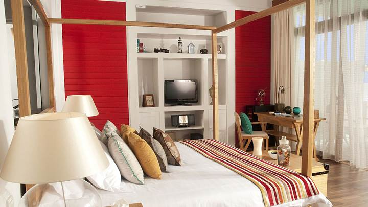 Wooden Bed And Furniture In Room At Sea Side