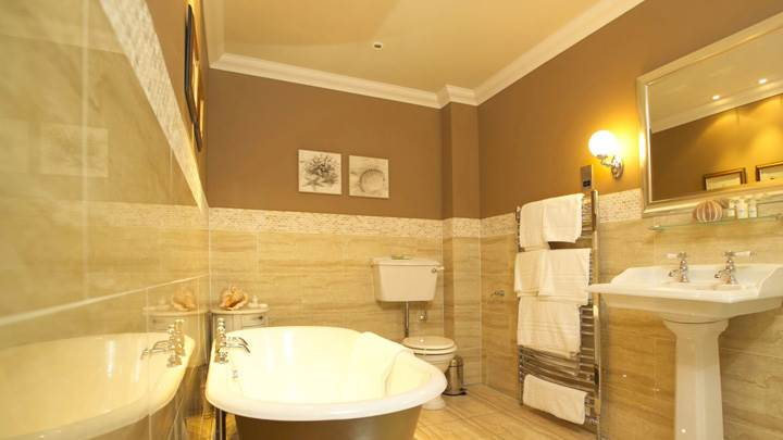 Wooden Color Interior In Bathroom And White Bathtub And Sink Wallpaper
